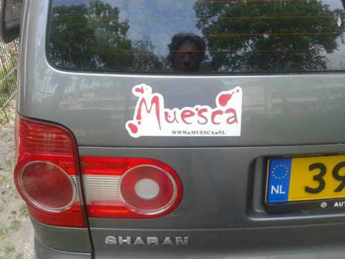 Muesca logo sticker on car.